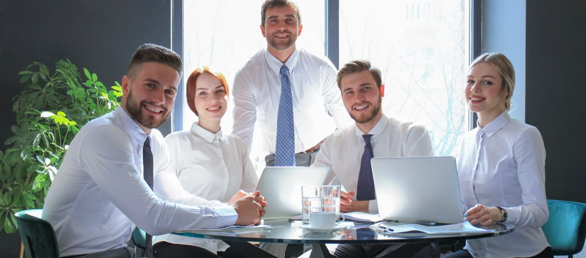 Portrait of a positive business employees at office business meeting